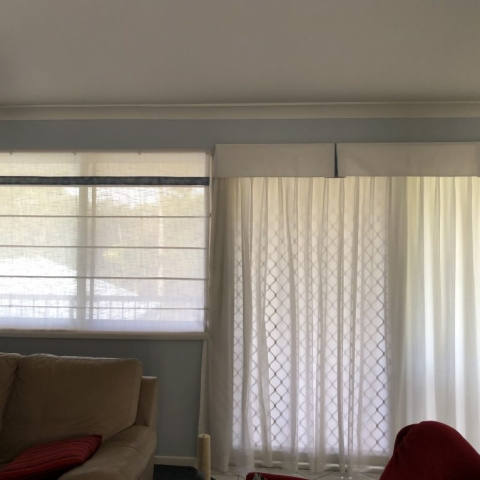 Soft roman blinds with matching curtains and valances