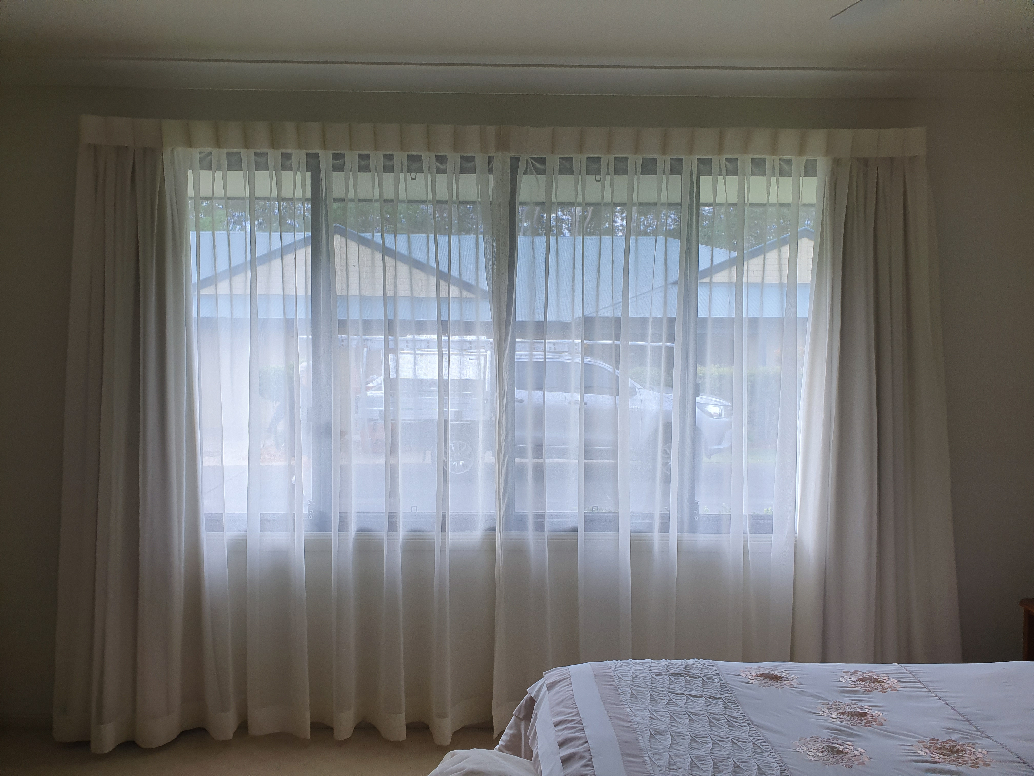 Soft voile sheer curtains reverse pleat hemmed double track lining