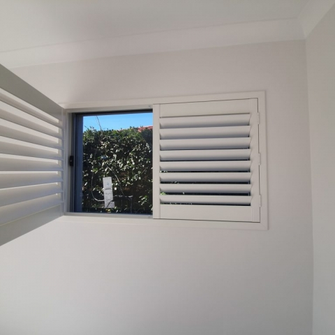 White eco timber-look shutters hinged panel frame