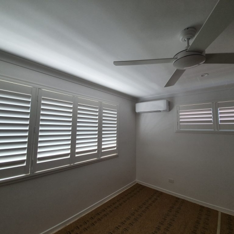 White eco timber-look shutters