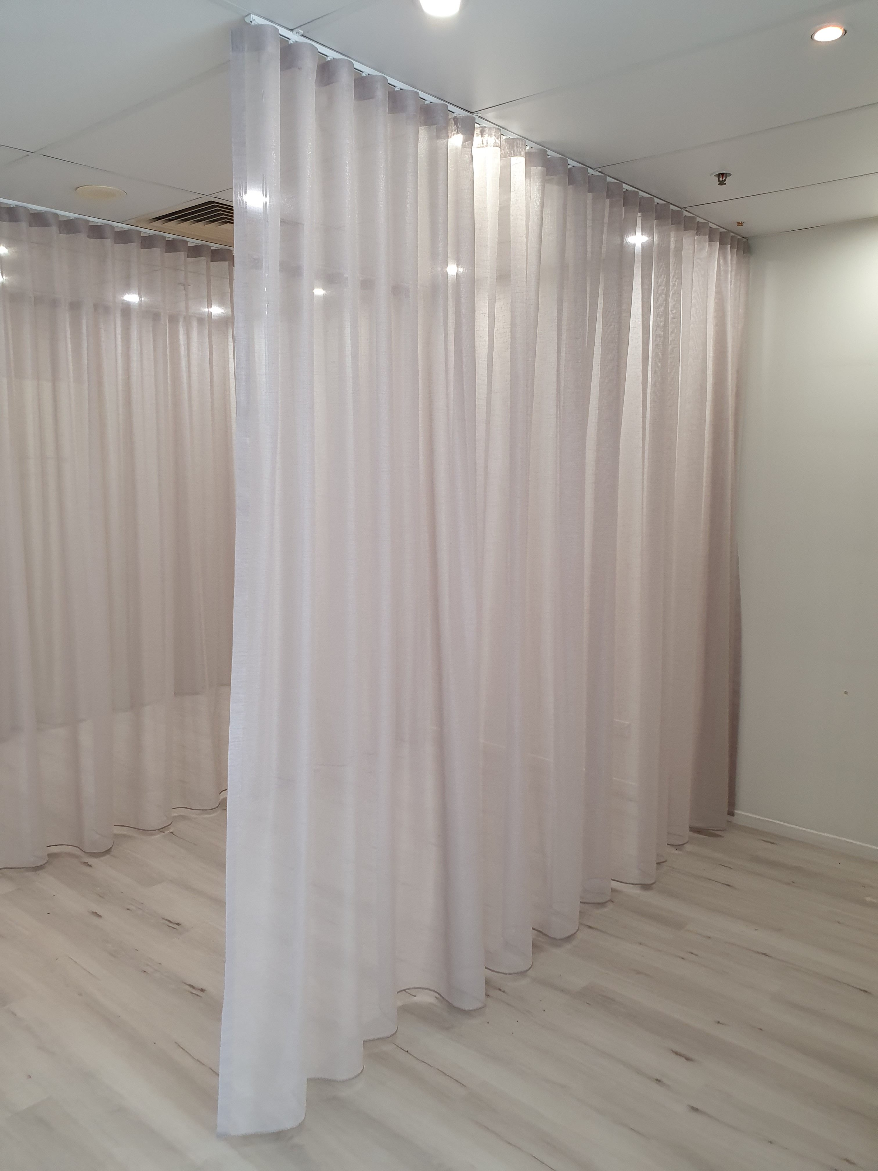 Shimmery S-Wave sheers for a commercial fit-out ceiling to floor
